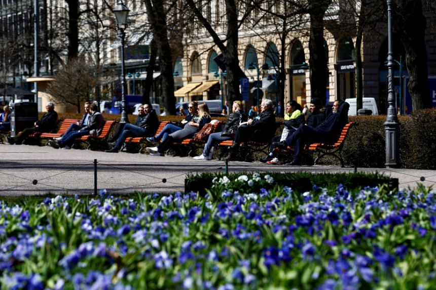 People enjoying a sunny day at the Esplanade in Helsinki, Finland, on May 3, 2017.