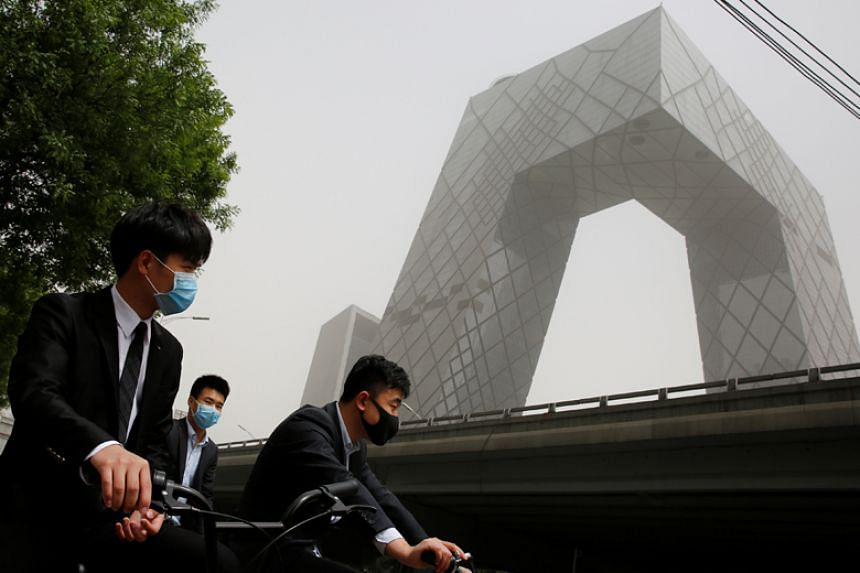 The China Central Television (CCTV) Tower in Beijing. Every year CCTV uses hidden cameras to highlight what the network calls companies' unfair practices against consumers.