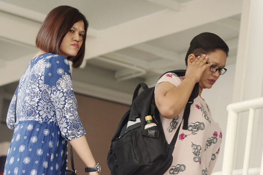 (From left) Sisters Haslinda and Hasniza Ismail and their mother Hasmah Sulong (not pictured) were each charged with one count of causing grievous hurt to a 27-year-old woman.
