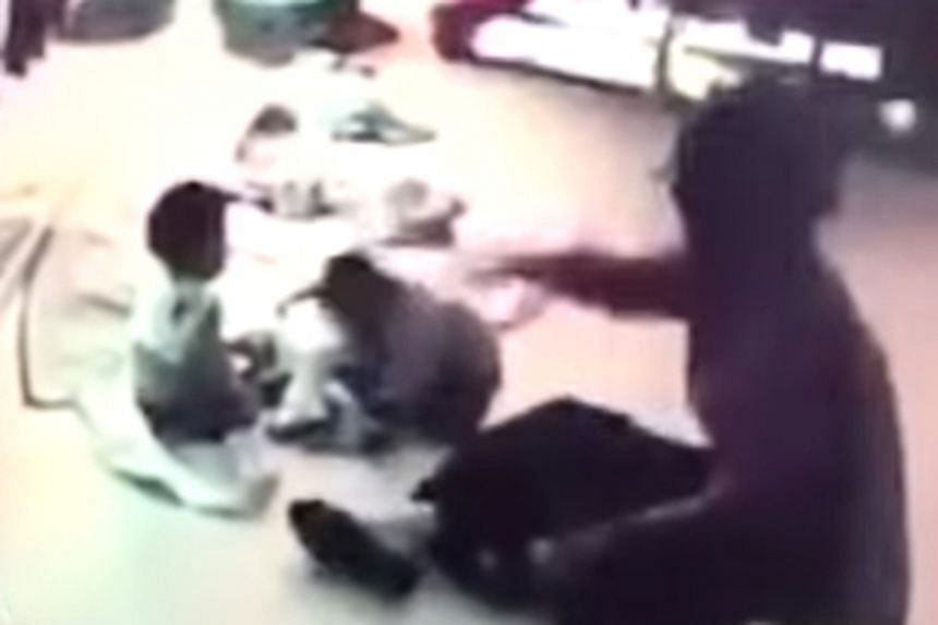 The nanny was caught on camera hitting a child on the back of her head and throwing the child on the ground several times.