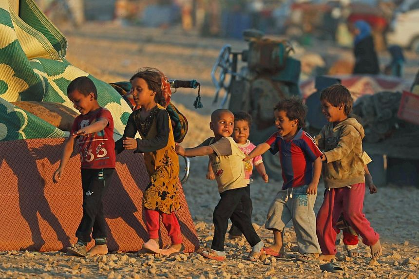 Children play inside a refugee camp in Ain Issa, Syria on Oct 3, 2017.