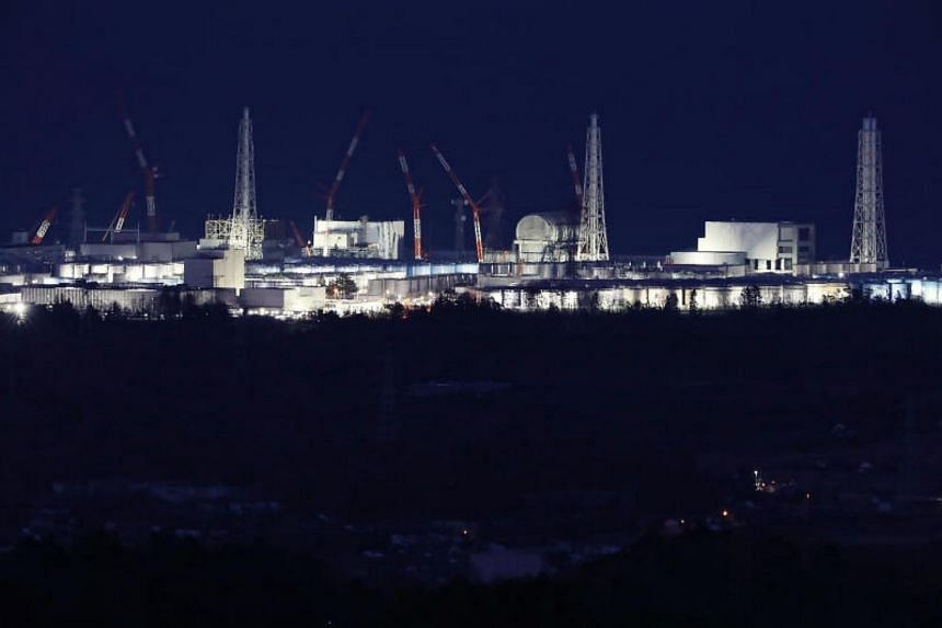 The Fukushima Daiichi nuclear power plant being lit up in Okuma, Fukushima prefecture, on the eve of the seventh anniversary of the 2011 Great East japan earthquake.