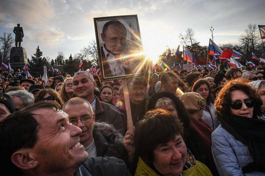 Supporters of Russian President Vladimir Putin gather for a rally in Sevastopol's Nakhimov Square.