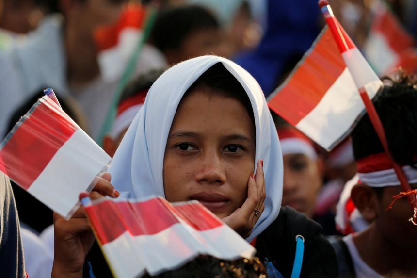 A student at the celebrations for the 72nd anniversary of the Indonesia military, in Cilegon, Indonesia Banten province, on Oct 5, 2017. Indonesia is the third biggest democracy globally behind India and the United States.