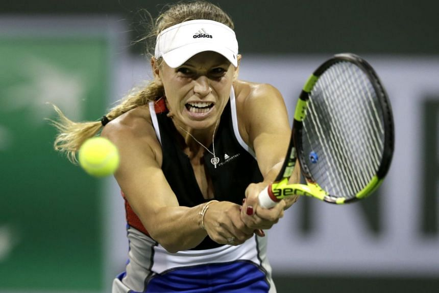Caroline Wozniacki of Denmark in action against Daria Kasatkina of Russia during the BNP Paribas Open tennis tournament at the Indian Wells Tennis Garden in Indian Wells, California on March 13, 2018.