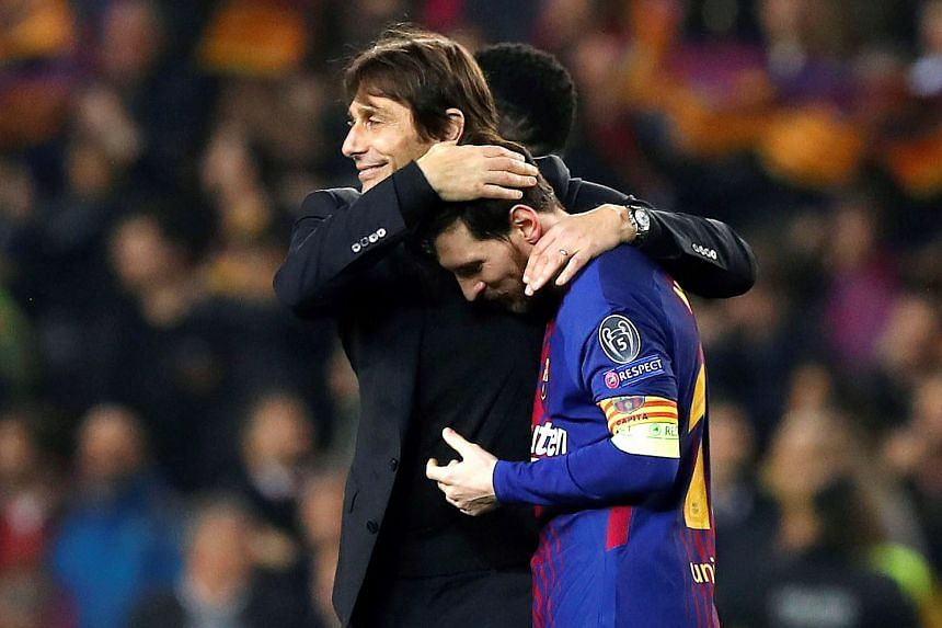 Conte congratulates Barcelona's Lionel Messi after their Champions League win against Chelsea.