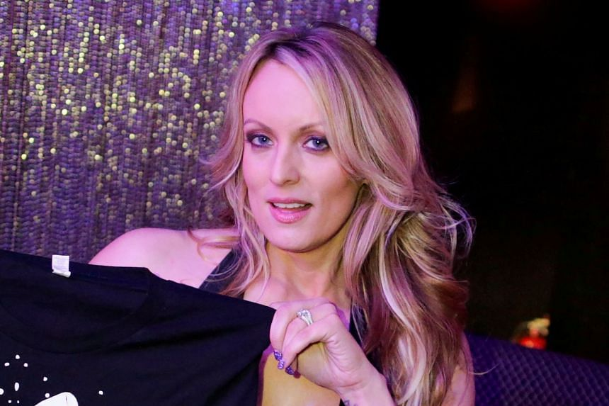 Adult-film actress Stephanie Clifford, also known as Stormy Daniels, poses for pictures in February 2018.