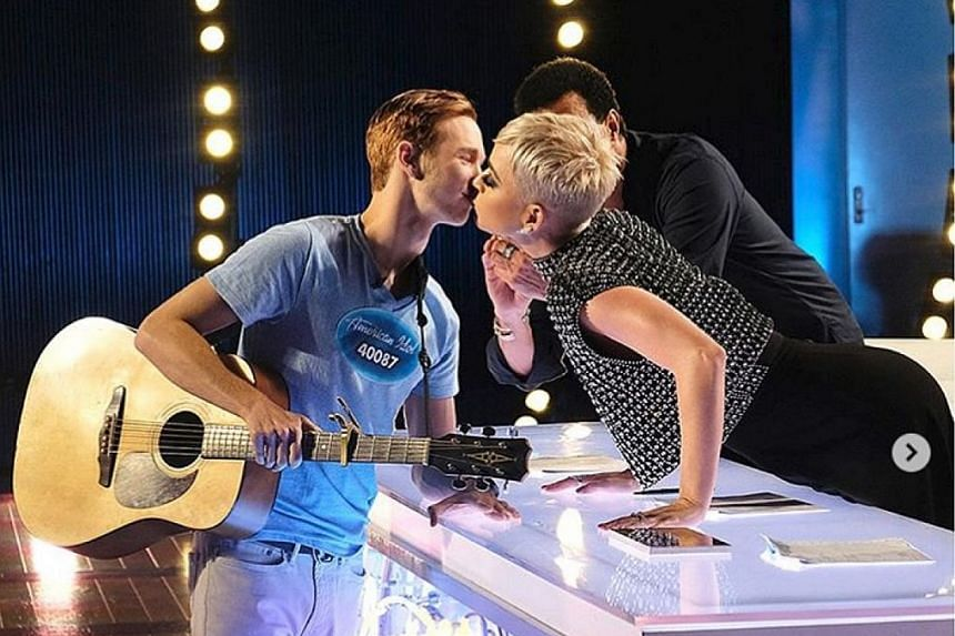 American Idol contestant Benjamin Glaze being kissed by judge Katy Perry. M. Ramlee died on Wednesday after a month in hospital.