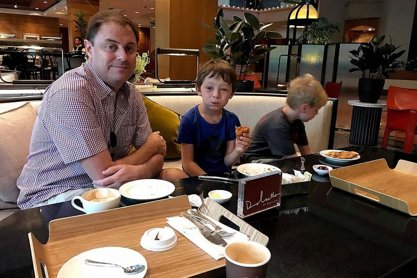 Mr Blair Haynes and his two children, Baxter (middle) and Flynn. His family booked through Airbnb's website (below) the two-bedroom unit in Caribbean at Keppel Bay for four nights. But the family was turned away last Friday by security guards at the