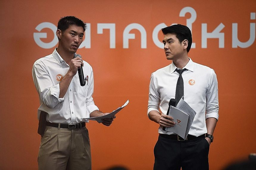 Tycoon Thanathorn Juangroongruangkit (left) and Assistant Professor Piyabutr Sangkanokkul, the co-founders of Future Forward, at the party's official launch event in Bangkok yesterday.