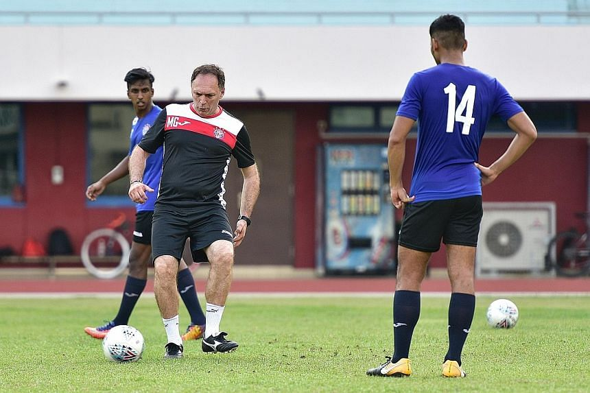 New Warriors FC coach Mirko Grabovac, a five-time S-League top scorer, showing how it is done during training at Choa Chu Kang Stadium. He arrived in Singapore on Jan 13 and received his employment pass a week ago.