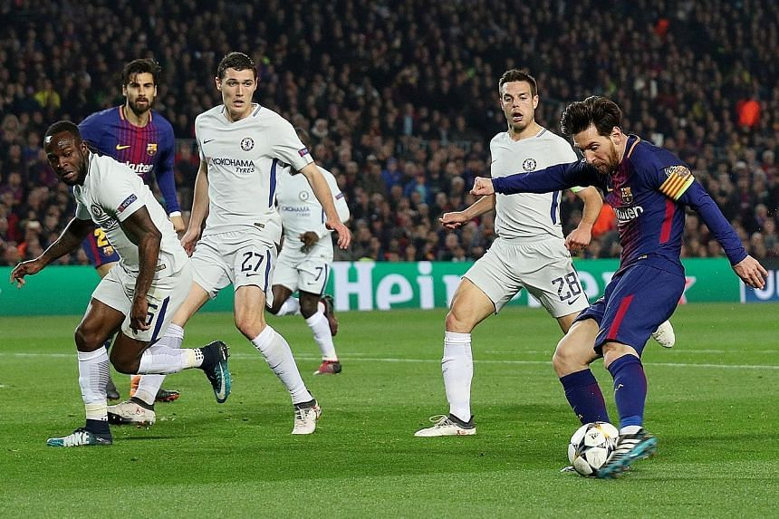 Above: Lionel Messi scoring Barcelona's third and his second of the night after the forward's burst of acceleration put him clear of the Chelsea backline of (from left) Victor Moses, Andreas Christensen and Cesar Azpilicueta. Left: The Argentinian em