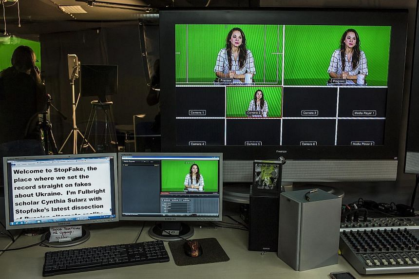 The host of the English-language version of StopFake News is seen on monitors before a broadcast from the programme's studio in Kiev. StopFake was co-founded by Mr Ruslan Deynychenko (above), and staffed by about 30 journalists, academics, IT special