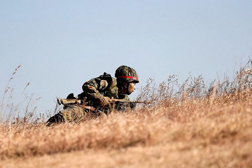 A member of Japan's Ground Self-Defence Force taking part in an annual new year military exercise in Funabashi, east of Tokyo, in January. Japanese Premier Shinzo Abe wants to insert an explicit reference to the Self-Defence Forces in Article 9 of th