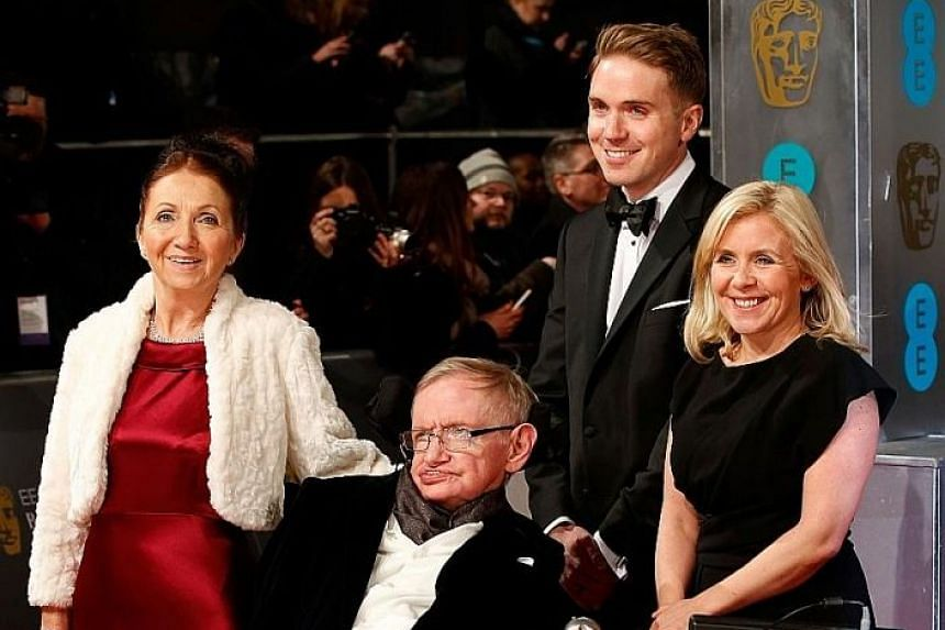 Professor Stephen Hawking with his former wife Jane (left) and daughter Lucy at the British Academy Film Awards in London in 2015. The Cambridge University scientist died on Wednesday, aged 76.