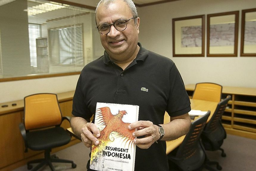 Public affairs strategist Vasuki Shastry with his book, Resurgent Indonesia: From Crisis To Confidence, at The Straits Times bureau in Jakarta on Tuesday. The former Indonesia bureau chief for The Business Times hopes to show how Indonesia blended de