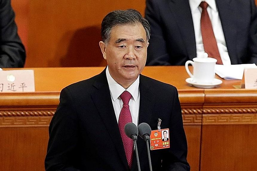 Above: Mr Wang Yang, new head of the CPPCC, said its founding showed China's political parties, sectors of society and nationalities had chosen the CCP's leadership and that 70 years of practice showed this choice was correct. Left: Chinese President