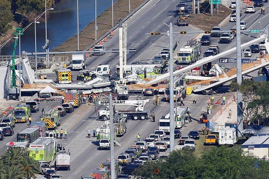 At least eight vehicles were trapped in the wreckage of the 950-ton bridge and at least 10 people have been transported to hospitals, officials and doctors told news conferences.