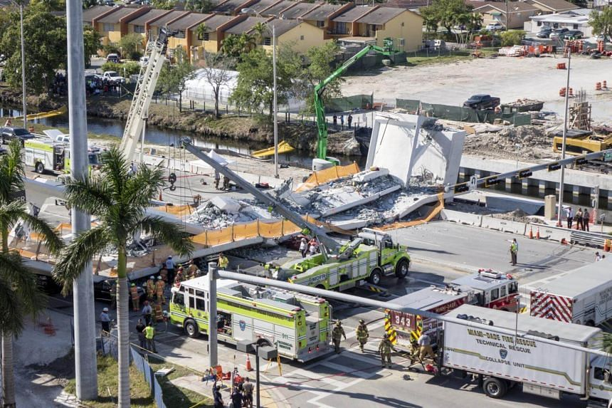View of the collapsed pedestrian bridge on the Florida International University in Miami on March 15, 2018.