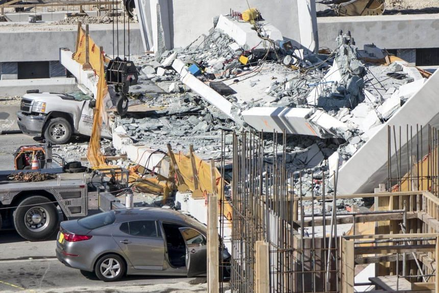 Witnesses told local media the vehicles were stopped at a traffic light when the bridge collapsed, and authorities said there still may be more vehicles trapped underneath.