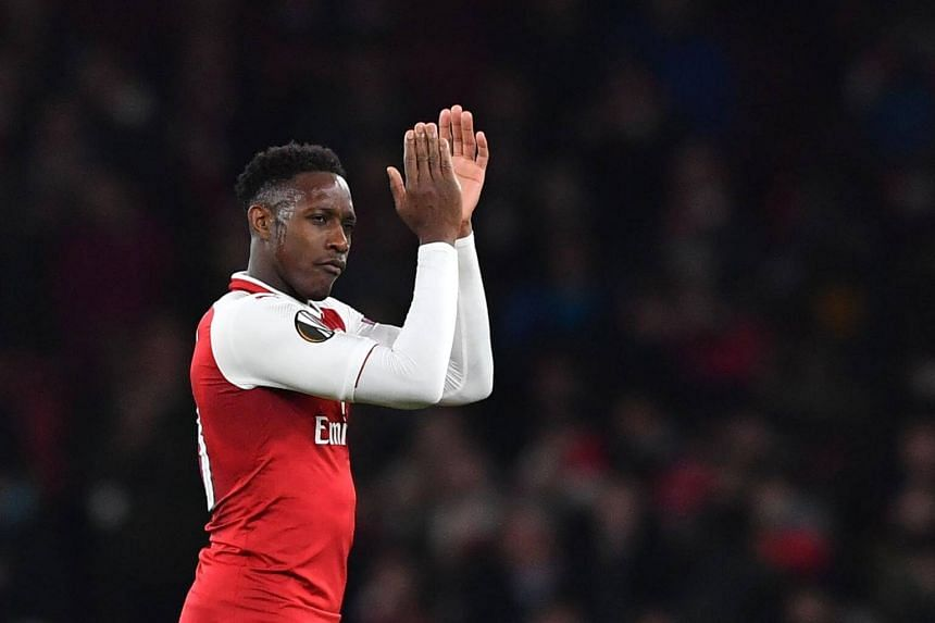 Arsenal's English striker Danny Welbeck gestures at the final whistle during the Uefa Europa League round of 16 second-leg football match between Arsenal and AC Milan, on March 15, 2018.