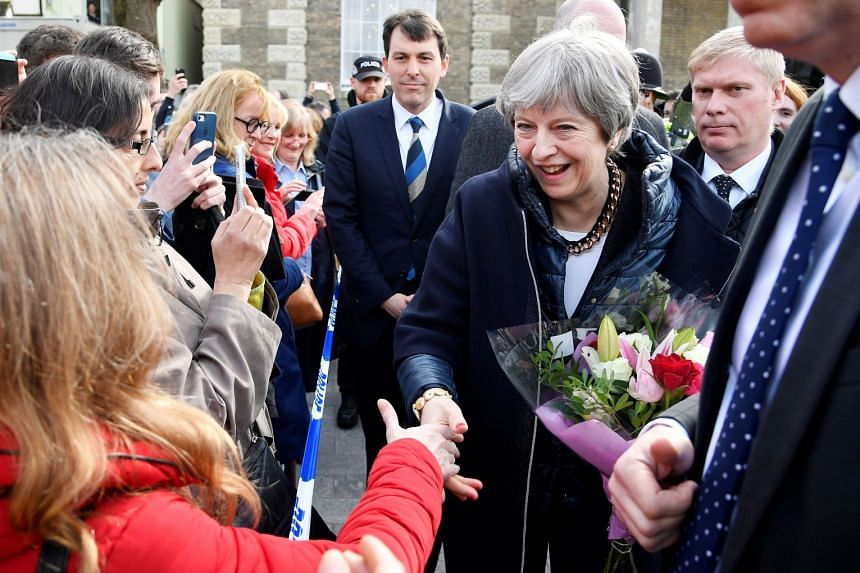 May meeting members of the public during her visit to Salisbury on March 15, 2018,