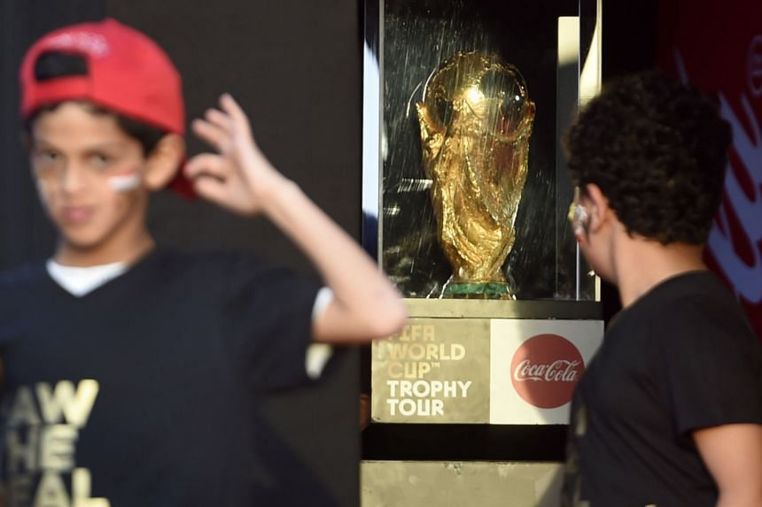 An Egyptian youth looks at the World Cup trophy as it visits Cairo as part of a global tour.