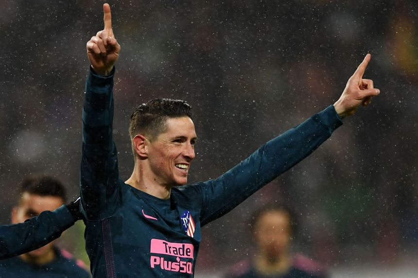 Torres celebrates after scoring the team's fourth goal.