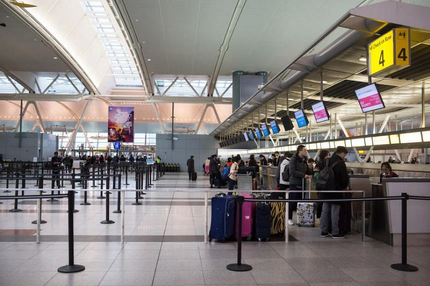 Travellers check in for a flight at John F. Kennedy International Airport in New York, US on March 7, 2018.