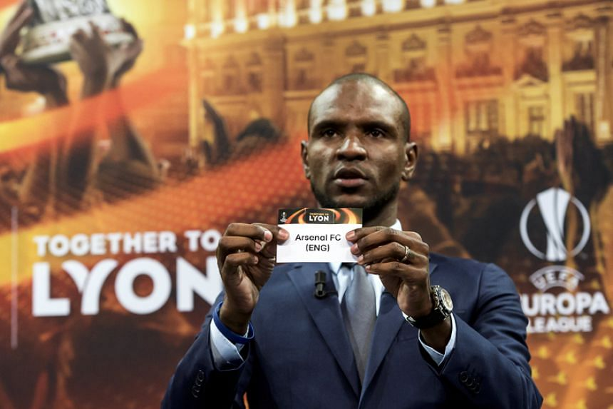 Former French footballer Eric Abidal shows the slip of Arsenal during the draw of the Uefa Europa League quarter-finals around at the Uefa Headquarters in Nyon, Switzerland, on March 16, 2018.