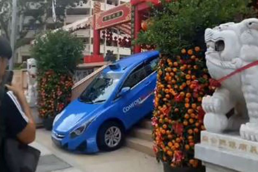 The cabby had just dropped a passenger off at the temple in Yishun Industrial Street 1 and was driving off when he mistook the staircase area for the exit.