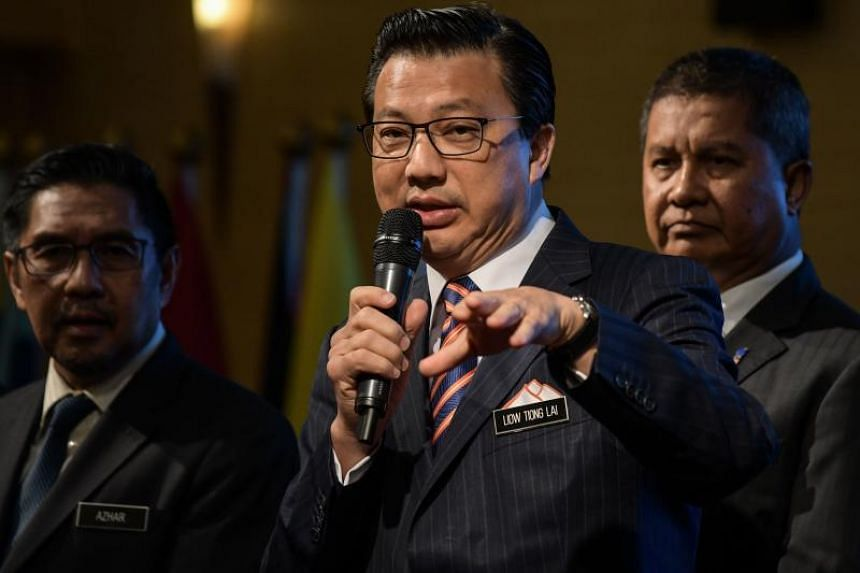 Malaysia's Transport Minister Liow Tiong Lai (C) speaks during a press conference at the Malaysian federal administrative centre in Putrajaya, outside Kuala Lumpur, on Jan 10, 2018.
