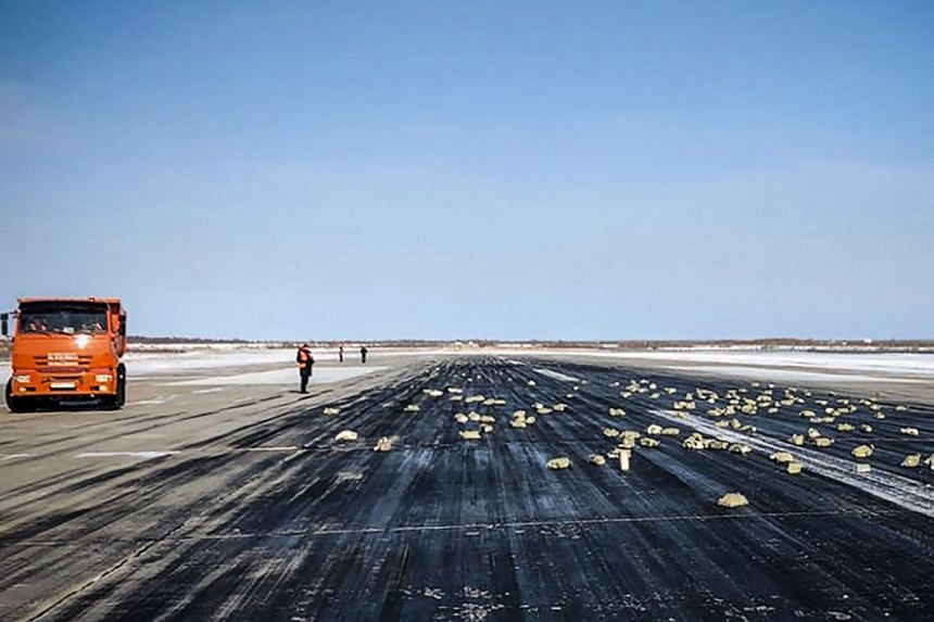 A handout picture provided by YakutiaMedia news agency shows precious metal ingots on the runway of the airport of Yakutsk.