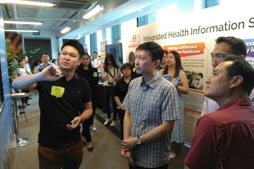 Senior Minister of State for Communications and Information and Health Chee Hong Tat during a tour of Health Tech Day at SMU Labs, on Friday (March 16).