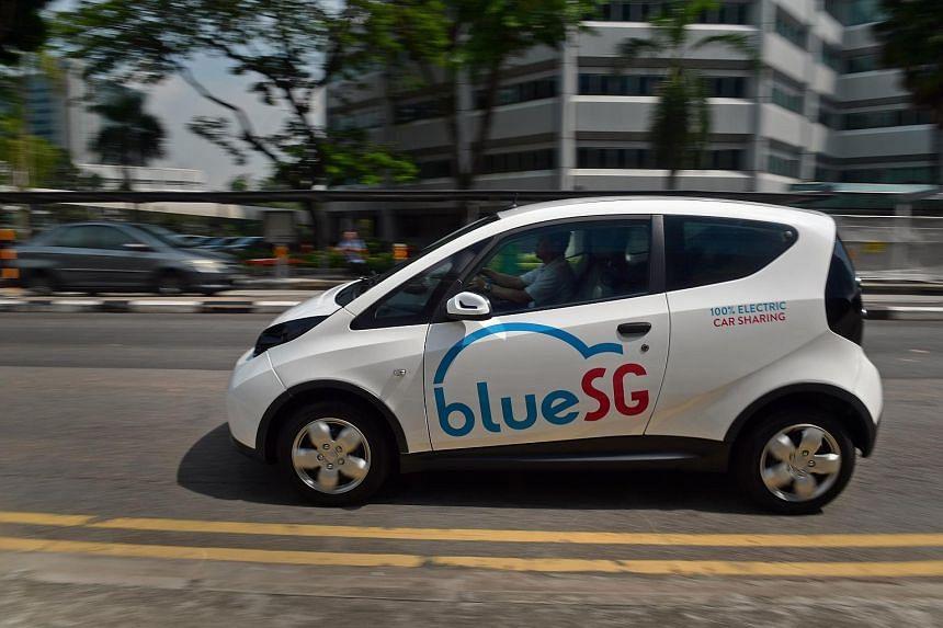 A man drives a BlueSG electric car along Science Park Drive on Sept 27, 2017.