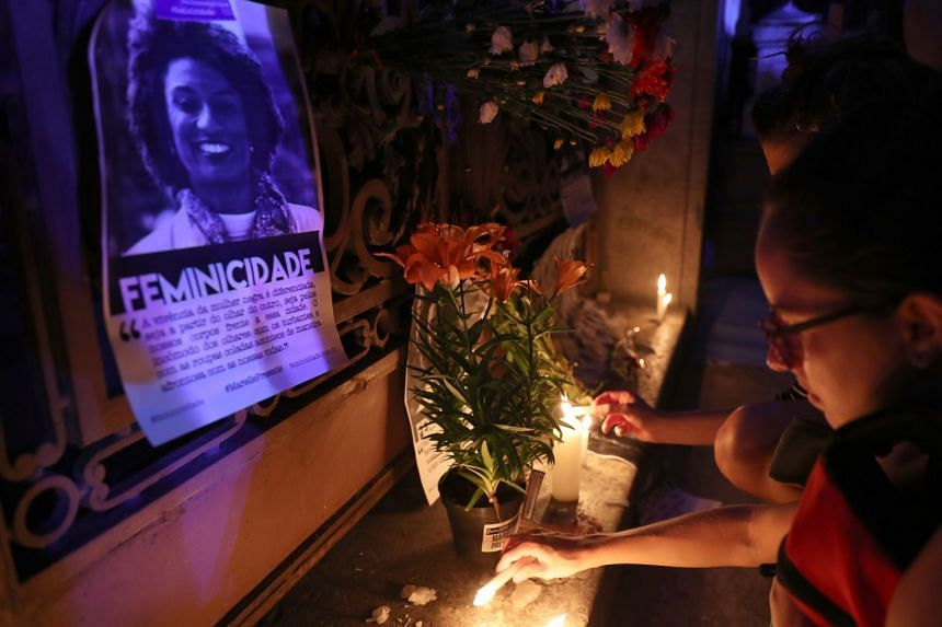 A crowd pays tribute to Marielle Franco, the councilor and human rights activist, in Rio de Janeiro, on March 15, 2018.
