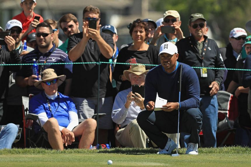 Tiger Woods lines up a putt on the seventh hole during the first round at the Arnold Palmer Invitational.