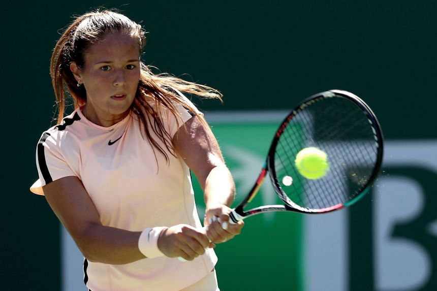 Kasatkina of Russia returns a shot to Angelique Kerber of Germany.
