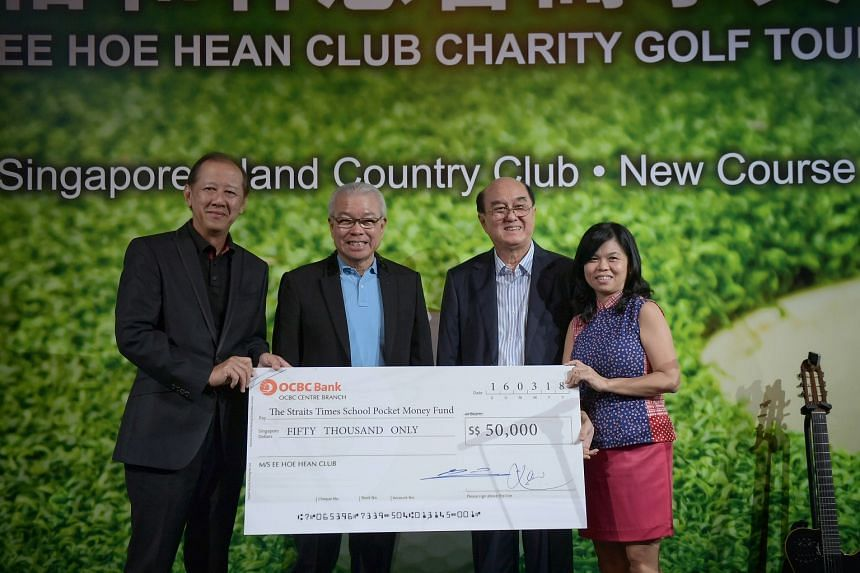 Ee Hoe Hean Club presents a cheque for $50,000 to The Straits Times School Pocket Money Fund after a charity golf tournament at the Singapore Island Country Club on March 16, 2018.