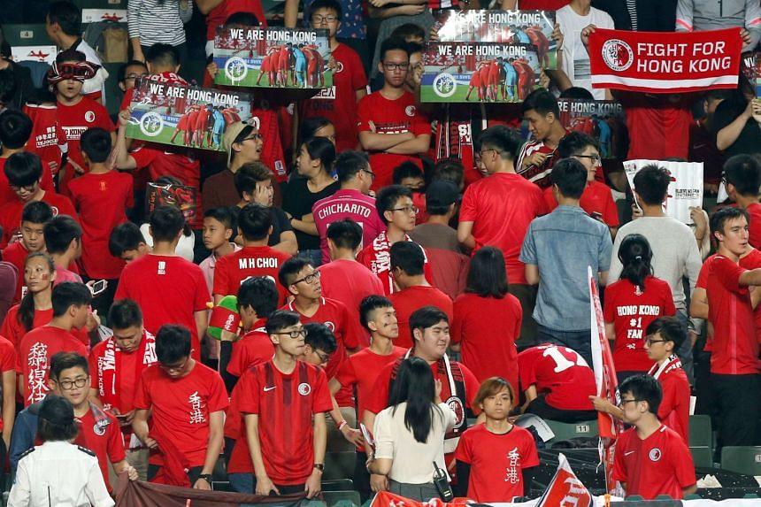 Hong Kong fans turn their backs and boo during Chinese national anthem at the Asian Cup preliminary match between Hong Kong and Lebanon in Hong Kong on Nov 14, 2017.