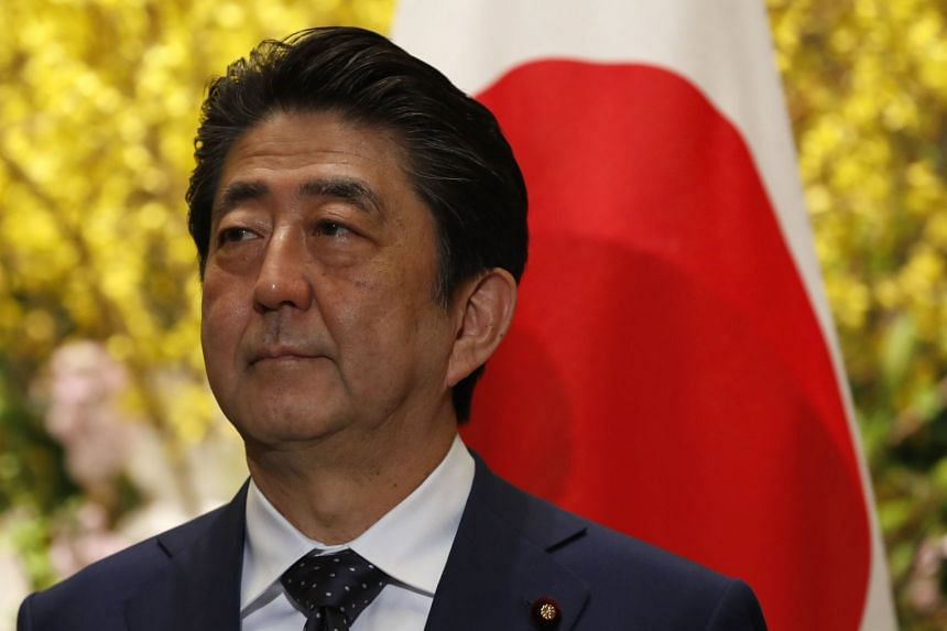 Japanese Prime Minister Shinzo Abe (pictured) expressed his wish for talks during a telephone call with South Korean President Moon Jae In.