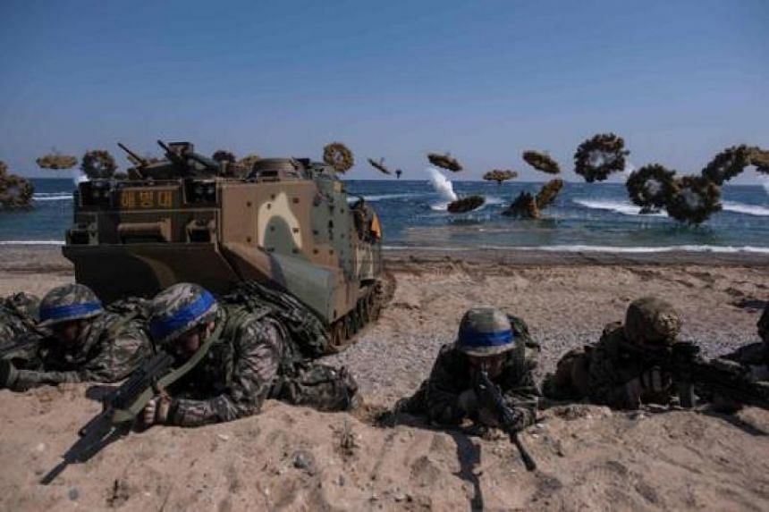 South Korean and US soldiers at an annual joint military landing exercise in Pohang on South Korea's southeast coast, on March 12, 2016.