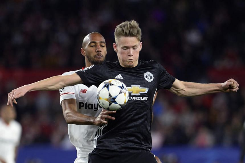 Manchester United's Scott McTominay vies for the ball with Sevilla's Steven N'Zonzi during the UEFA Champions League round of 16 first leg football match at the Ramon Sanchez Pizjuan stadium in Sevilla on Feb 21, 2018.