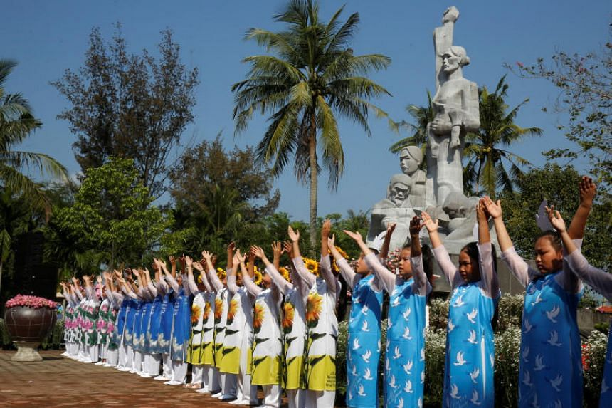 Schoolgirls perform during the 50th anniversary of the My Lai massacre in My Lai village, Vietnam on March 16, 2018.