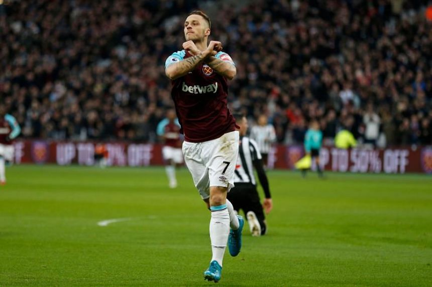 West Ham United's Marko Arnautovic celebrates after scoring the opening goal of the English Premier League football match against Newcastle United at The London Stadium on December 23, 2017.