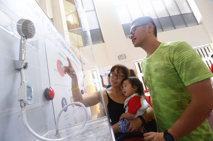 Smart shower devices on display at Hong Kah North Community Club on March 17, 2018. They will be installed at West Rock@Bukit Batok homes under the Smart Shower Programme.