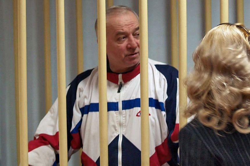 A 2006 photo showing Sergei Skripal talking from a defendant's cage to his lawyer during a court hearing.