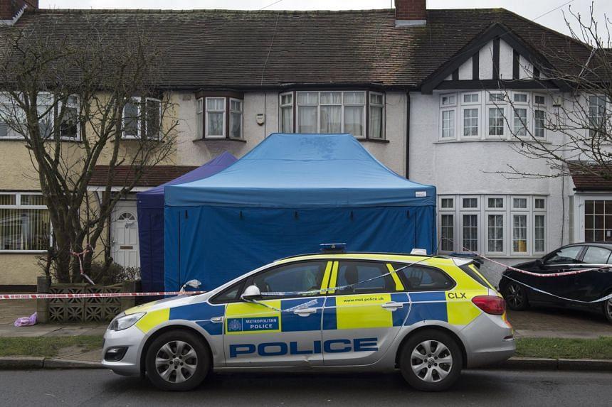 A police officer outside a property where the body of Nikolai Glushkov was found.