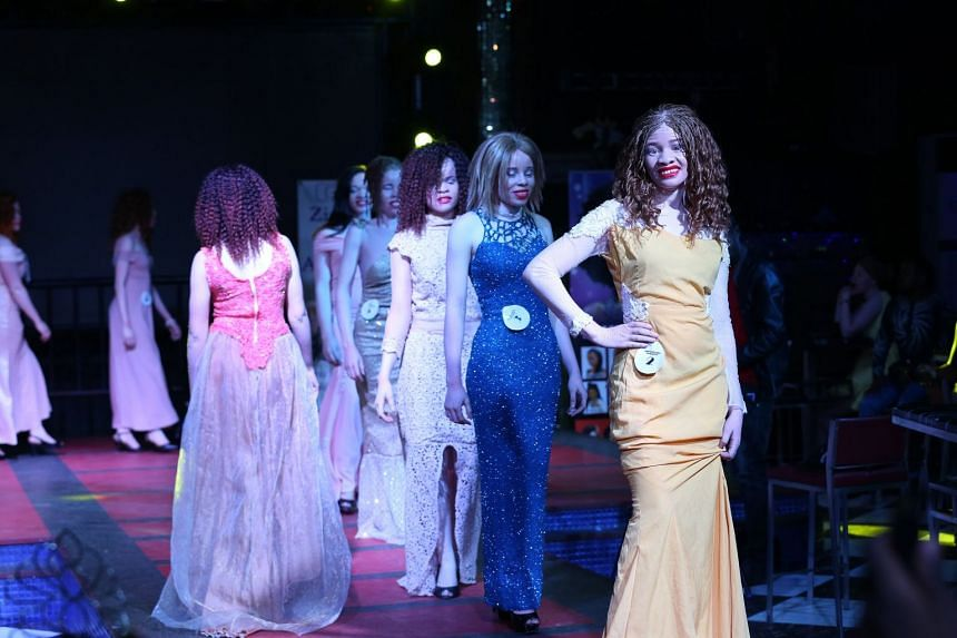 Women on the runway during a beauty contest featuring people with albinism in Harare, Zimbabwe.