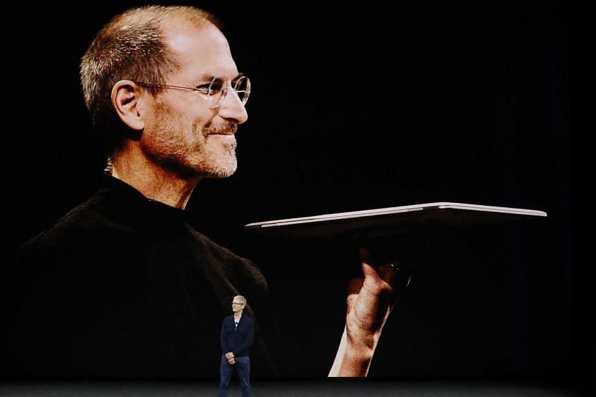 Apple chief Tim Cook speaking during a tribute to Steve Jobs at a product launch event in California.